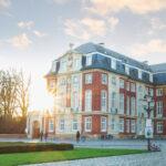 Das Schloss von Münster im Sonnenutnergang